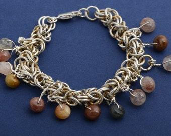 1 Silver  bracelet with alpaca links with tourmaline stones.