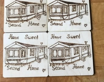 "Static caravan coasters, 4 wooden coasters with a wood burned picture of a static caravan with the caption  ""Home  Sweet Second Home "" on."