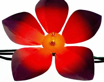 Decorative red die-cut flowers for string lights