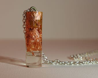 Gold Flakes Suspended in Clear Resin