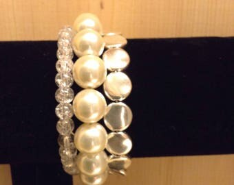 Large faux pearl and silvertone disk memory wire bracelet.