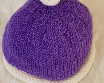 Knotted beanie with contrast from and top knot