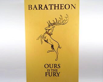 Wood engraved coat of arms (emblem) of the House of Baratheob. Game of Thrones.