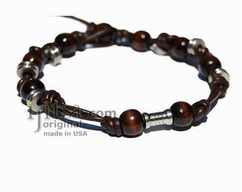 Leather bracelet or anklet with metal and wooden beads