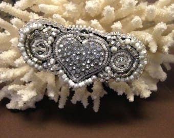 Clear Crystal and White seed beads hand beaded hair barrette on a black background