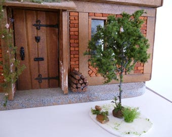 A tree for your one half inch scale garden !24th scale with dark green foliage, grass and rocks!
