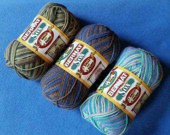 Bernat Sox Sock Yarn, one skein of variegated self-striping yarn in camouflage, wooded denim, or hippi hot - 1 ball makes 1 pair