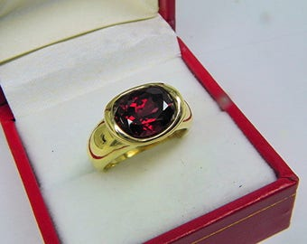 AAAA Rhodolite Garnet  3.45 carats  10x7.9mm in 14K Yellow gold bezel set ring.  0254