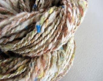 Sandstone.  Handspun Collage Art Yarn with recycled fibers