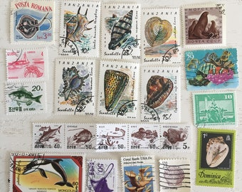 Lot of 22 Ocean Life cancelled postage stamps Sea shells Sea Life Fish Whales Ephemera