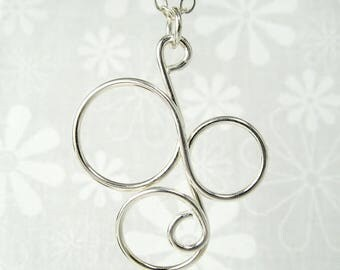 CIRCUS PENDANT, sterling silver circle pendant