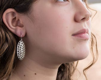 Sterling silver dangle earrings, perforated ovals, shiny, 38mm.