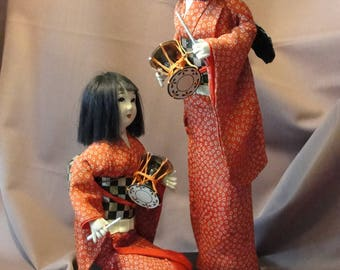 Vintage cloth and wood sculpture of Japanese drummers in red Kimono Made in Japan