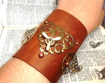 Steampunk Distressed Brown Genuine Leather Arm Wrist Cuff Bracelet with Spinning Propeller and Vintage Filigree Key Hole Accents