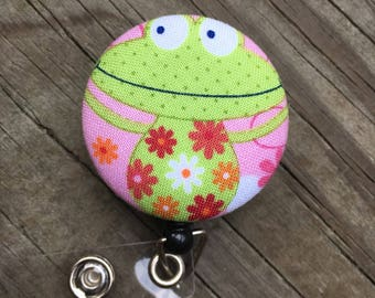Whimsical badge button holder silly frog design