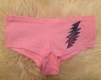 Multicolor Grateful Dead Lightning Bolt on Pink Booty Shorts - size medium