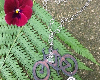 Bike, necklace, with heart and rhinestones. Silver chain.