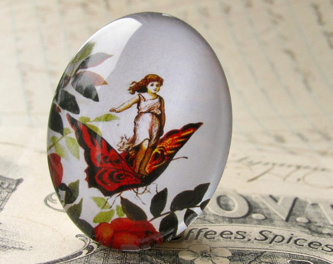 Fairy riding on a butterfly, handmade 40x30 40x30mm  glass oval cabochon, fantasy stories, Victorian children's books, white, red, green