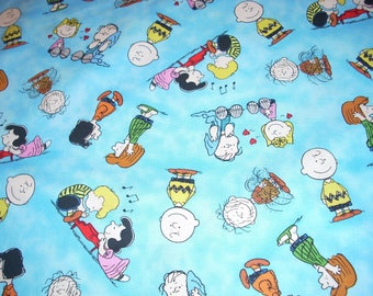 """Peanuts Characters on blue cotton fabric - 43"""" wide - sold by the yard"""