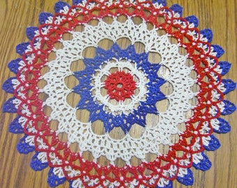 red white and blue crocheted doily