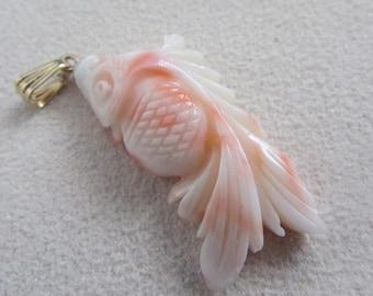 Angel skin coral hand carved fish  pendant,14 k loop.