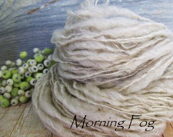 Thick and thin bulky hand spun yarn homegrown wool chunky natural colors Morning fog gray oatmeal