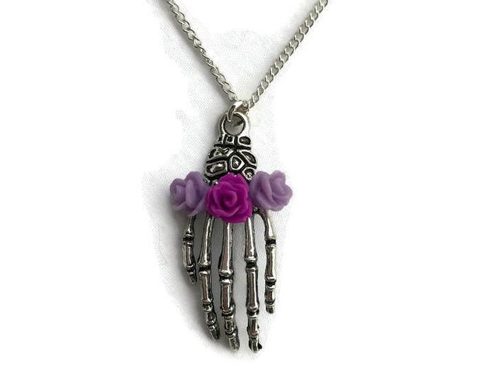 Featured listing image: Silver Skeleton Hand Necklace with Purple Roses, Women's charm necklace, Halloween, Spooky, Creepy, Bone Hand, Gothic, Day of the Dead