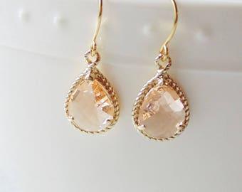 Champagne peach glass gold tear shape dangle drop earrings. Bridal earrings. Bridesmaid earrings. Wedding jewelry.