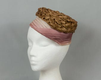 Vintage pillbox hat Braided brown rafia top Sides pleated satin Ends in twist on the side Unique pillbox hat Secure with hat pin
