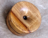 Reversible pocket spinning surface for supported spinning in Jamaican Fiddlewood and Dymondwood