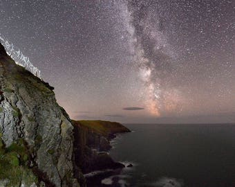 the oldhead of kinsale cliffs at night with the milkyway