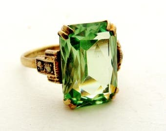 Art deco gilt sterling silver and green glass paste ring by Thomas L Mott