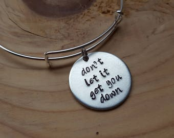 """SALE- Quote Bangle Bracelet- """"don't let it get you down""""- hand-stamped bracelet- only 1 available"""