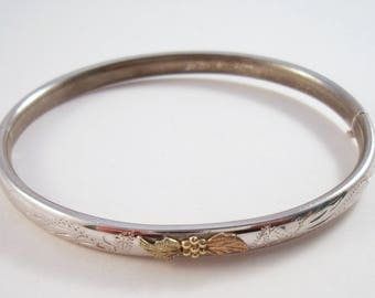 Sterling bangle bracelet etched with gold leaf design, hinged bangle