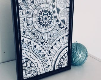 Hand drawn mandala in black frame