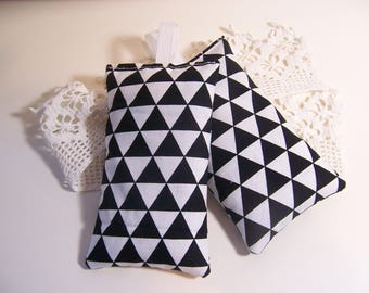 Set of two hanging lavender sachets in a modern black and white fabric sachet for your drawers or your bathroom . sleep aid or small gift.