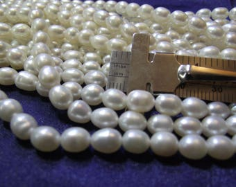 Beautiful 6 mm Fresh Water White Oval Pearls 1 strand P lot 013