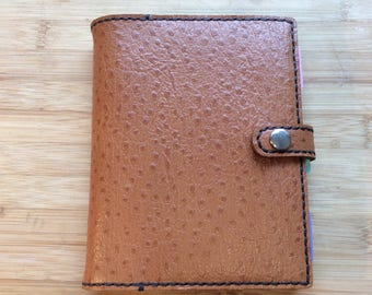Handmade and reusable, leather A6 notebook cover complete with ruled A6 notebook