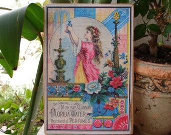 stunning,Murray & Lanman Florida water-perfume,vintage advertising image,sign on wood.