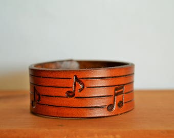 Leather cuff with hand stamped music notes - Hand tooled