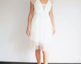 Bridal dress in tulle plumetis