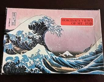 Book of Hokusai prints and poems.