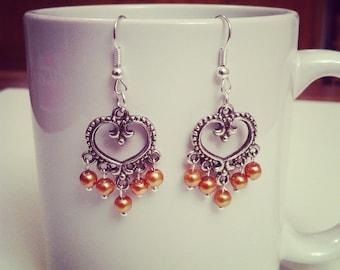 Yellow ocher beads hearts earrings