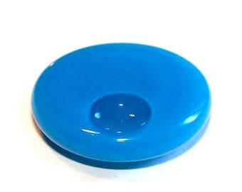 A globe round 30 mm blue opaque liquid filled glass