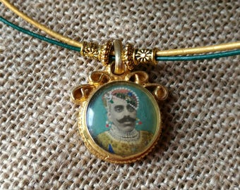 CHARMING Maharaja portrait on gold plated silver pendant .