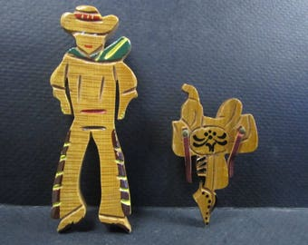 Two Wooden Cowboy Brooches