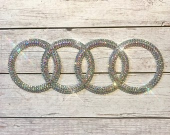 Bling car emblem- sparkly auto emblems- bling auto parts- bling car logos- bling audi rings- bling car accessories- custom car accessories-
