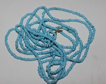 Vintage turquoise colored seed beads