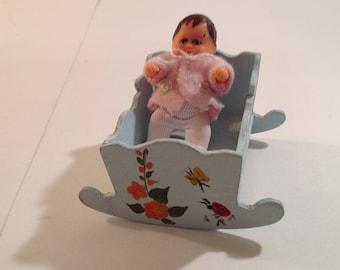 Vintage German Miniature Baby Doll in Hand Painted Wooden Rocking Cradle