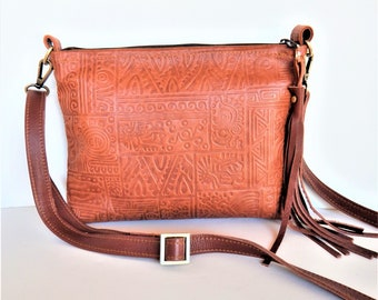 Brown leather crossbody bag, embossed leather, tan shoulder bag.